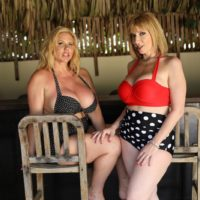 Elderly porn industry starlets Karen Fisher and Sara Jay have lesbian sex while on a glazed patio