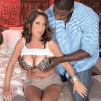 Older woman Karen DeVille is stripped by a ebony stud before taking his BIG BLACK DICK in hand