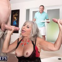 Aged gal Silva Foxx gives 2 boys oral job in front of her cuckold hubby