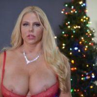 Middle-aged ash-blonde Karen Fisher lets a nip slip free of lingerie at X-mas time