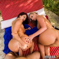 MILF adult movie stars Phoenix Marie and Ava Addams provide oral sex outdoors prior to anal sex