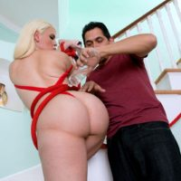 All natural ash-blonde Bedeli B. has her hefty arse oiled and fumbled while tied up in pumps