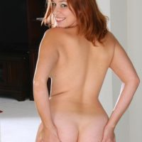 All natural ginger-haired grabs her provocative butt before showing her shaven snatch while alone