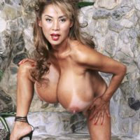 Elder Asian woman Minka shows her enormous breasts before unveiling her smoothly-shaven honeypot