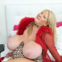 Aged light-haired Kayla Kleevage munches a nip while playing with her enlargened titties