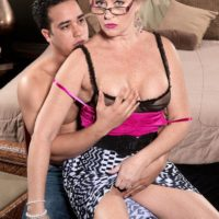 Over 50 ash-blonde MILF Tracy Licks her her immense breasts unsheathed before fellating a cock