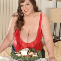 Plus-size hottie Jennifer takes a jizz geyser on her large titties while licking food
