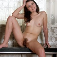 Petite European amateur with diminutive boobies showing off wooly vag in the naked