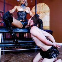 Light-haired bossy type Alexis Fawx mouth screws a sissy with a strap on dick in a basement