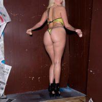 Platinum light-haired MILF Layla Price jerking suction fake penises at gloryhole in bikini and stilettos