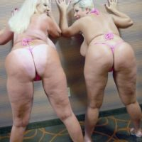 Pornographic stars Kayla Kleevage and Claudia Marie share a lezzy smooch after modelling bathing suits