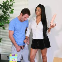 Sex education educator Jamie Valentine abasing her surprised students with a giant sex toy
