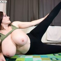 Enticing red-haired solo female Cleo extracts her enormous boobs during a yoga routine