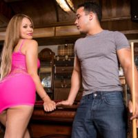 Slim Latina chick Samantha Bell letting her big bum loose from a taut dress in high-heeled shoes