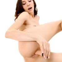 Solo female Adel Morel unsheathes her nice ass while getting bare naked to masturbate