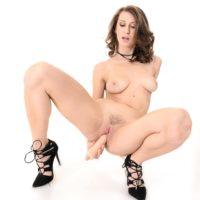 Solo chick Emylia Argan fuck-sticks her snatch after doffing wonderful lingerie in stilettos