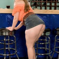 Solo female Jessica Taylor lets out her enormous titties at the bar with hair up in pigtails