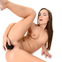 Solo female Kristy Black works frigs and a faux-cock up her smooth-shaven cunt once she is nude