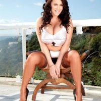 Solo female Leanne Crow frees her increased boobies on a balcony in tan pantyhose