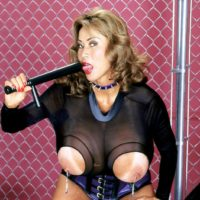Solo chick Minka showcases off her big titties in a cupless jumper and a waistline cincher