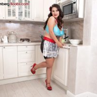Solo chick Stacy Vandenberg sets her hooters loose of a brassiere while baking in the kitchen
