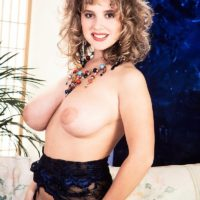 Solo chick with curly hair Tracy West sets her gorgeous tits loose of tempting lingerie