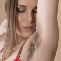 Solo model Donatella showcases off her wooly armpits and vagina in nude modelling debut