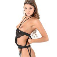 Solo model Melena Tara slams sex toys in her anus and cunt in ebony hose