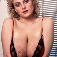 Solo model Suzanne Brecht frees her funbags and ass from seductive lingerie in rest room