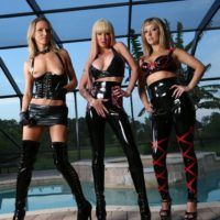 Spandex garbed Mistresses Alexia, Tyler and Alina prance about before manhandling a male sex slave