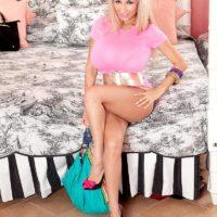 Spindly platinum-blonde MILF Venera loosing monster-sized fun bags from see thru lingerie in high heels