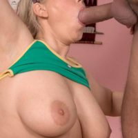 Inked blond sweetheart Lucy touting melons while providing giant cock blowjob