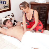 Tempting yellow-haired granny Nicol Mandorla seduces a stud with a back caress before banging him