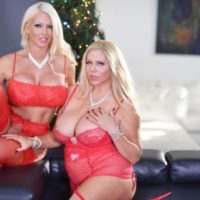Plumper golden-haired lady Karen Fisher and her lezzie wife model lingerie at Christmas