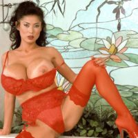Top Asian pornographic starlet Minka releasing her massive boobs from brassiere garbed red tights