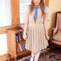 Young beauty Aubrey Star taking off coed uniform to pose nude for first time