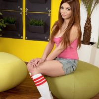 Young red-haired first timer Loreen flashing underwear after sliding off shorts in knee socks