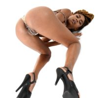 irresistible ebony chick Luna Corazon gets rid of spectacular lingerie before slurping on a sex toy by herself