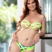 Mature red-haired lady Syren De Mer entices a youthfull stud before finger fucking during anal sex action
