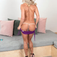 Aged platinum platinum-blonde Mandy Monroe strips to pumps while playing with sex toys