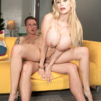 Humungous jugged blonde Sandra Starlet is freed from a short dress before sex on a couch