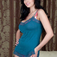 Brunette solo female Sha Rizel lets her hooters free of a brassiere after working clear of a thong