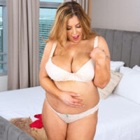 Fat solo chick Gia Costello licks a nip after uncupping her large boobs