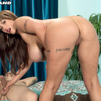 Bosomy tatted girl Eva Notty gets fully naked prior to tugging on an immense cock
