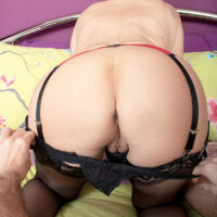 Redheaded grandmother Linda Storm does away with semi-transparent lingerie during oral and vaginal sex