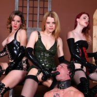 Dominant damsels manhandle male slaves with strap-on penises while in spandex clothing and boots
