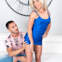 Yellow-haired cougar Mandy Monroe tempts a junior guy in a short sundress and stilettos