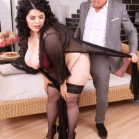 Big boobed brown-haired fatty Mara Miani sheds semi-transparent lingerie before screwing in stockings