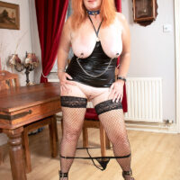 Big-titted senior ginger Melanie Taylor sports nipple clamps while paddling her hefty butt cheeks