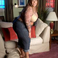 Large breasted big woman Karlee Adams tweaks her hard nipples before sliding her undies to the side
